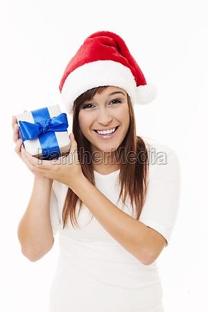 santa girl holding christmas gift