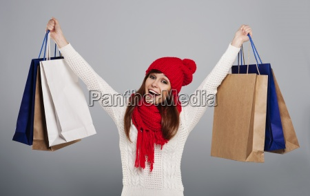 excited woman holding a lot of