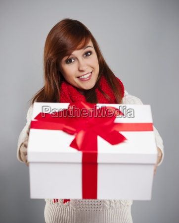 brunette young woman giving white christmas