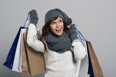 young woman loving winter sale