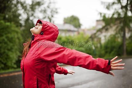 female enjoying rain