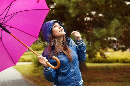 beautiful woman with umbrella looking at