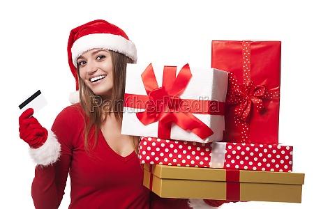 woman wearing santa hat holding christmas