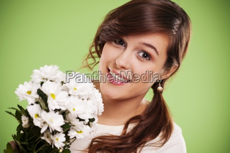 attractive young woman with white daisies