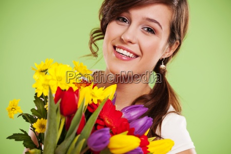happy young woman with flowers