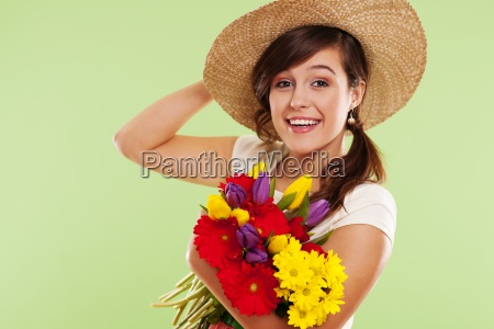 smiling brunet woman with hat and