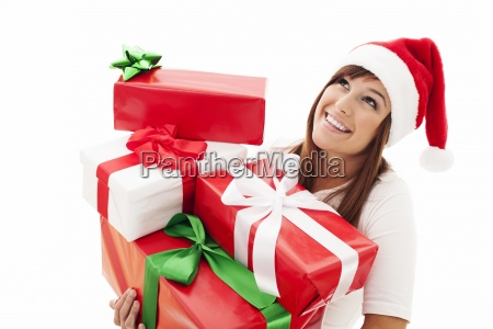 happy, woman, with, stack, christmas, gifts - 12110220