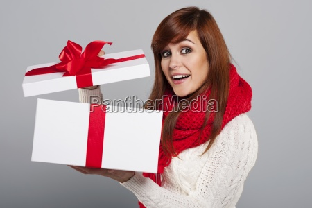 happy, young, woman, opening, christmas, gift - 12110300