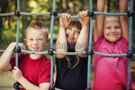 happy children holding a net on