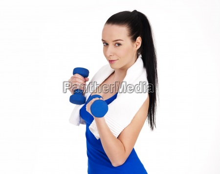 smiling woman holding dumbbells