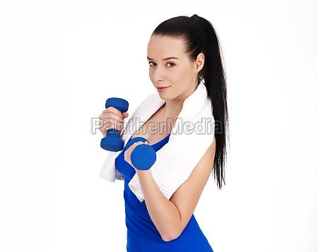 smiling woman holding dumbbells