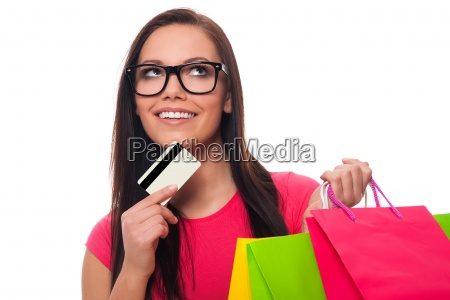 young woman planning shopping list