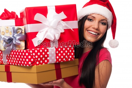 woman wearing santa hat holding stack