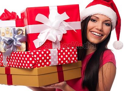 woman wearing santa hat holding stack