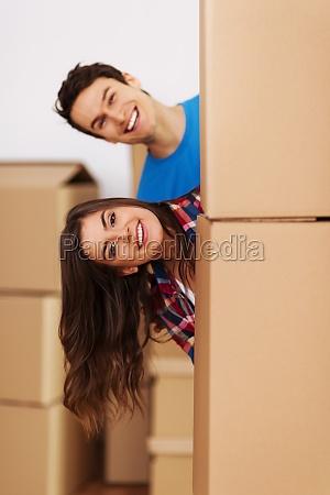 couple having fun during moving
