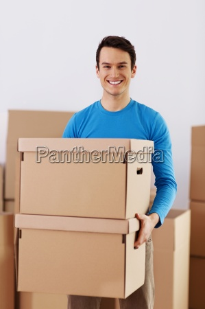 happy young man holding a cardboard