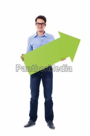smiling man holding green arrow