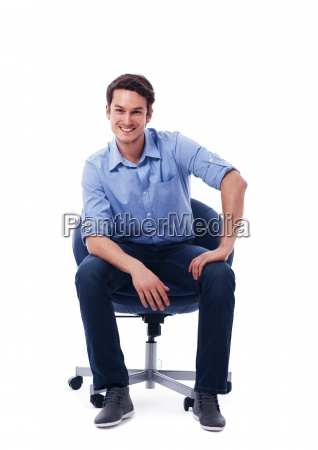 handsome male sitting on chair