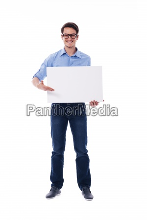 man wearing glasses holding white board