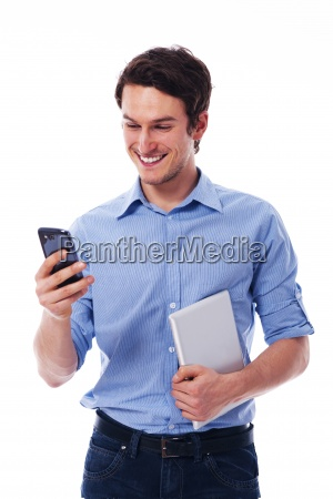 smiling man using wireless devices
