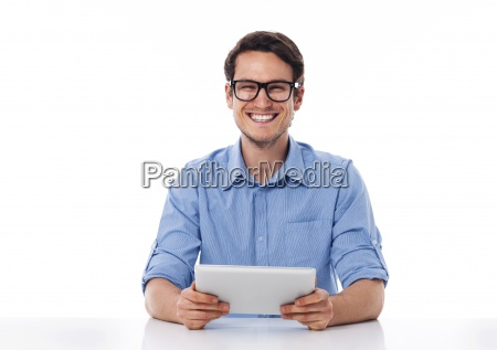 happy male holding a digital tablet