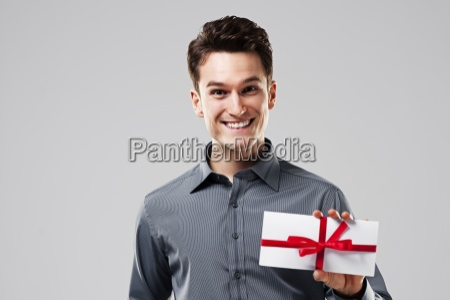 happy man holding white card