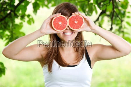 young woman having fun with fruits