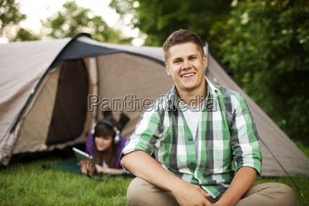 young man sitting in front of