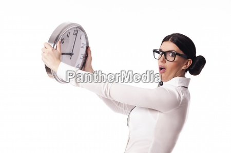 shocked woman holding a office clock