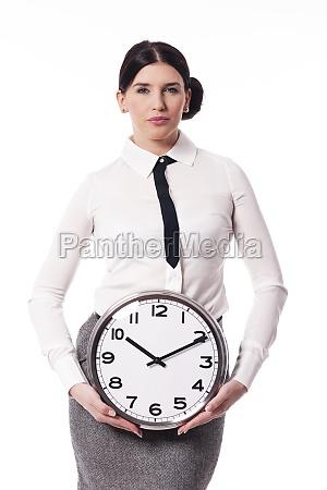 beautiful businesswoman holding a clock