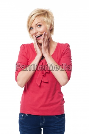 portrait of excited blonde woman