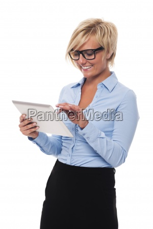 beautiful businesswoman wearing glasses using digital