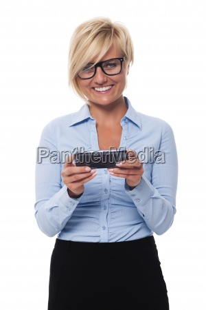 smiling businesswoman holding smart phone and