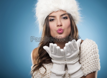 beautiful young woman blowing kisses