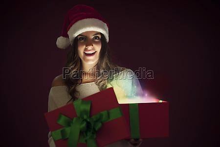 woman with santa hat opening magic