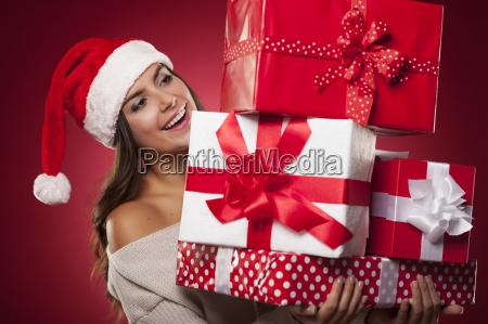 cute young woman wearing santa hat