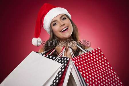 smiling woman with christmas shopping