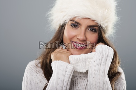 beautiful young woman wearing big fur