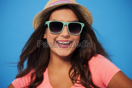 summer woman wearing sunglasses and straw