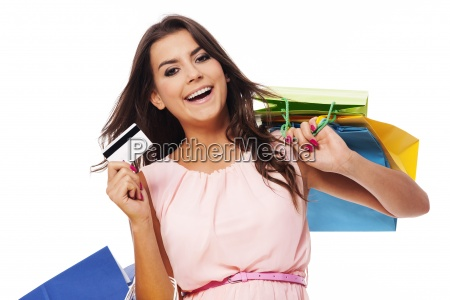 happy woman holding shopping bag and