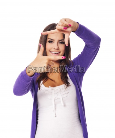 young woman showing fingers frame