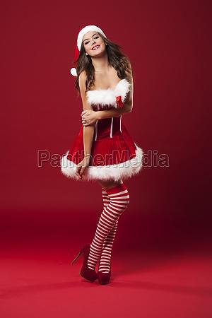 happy young woman posing in santa