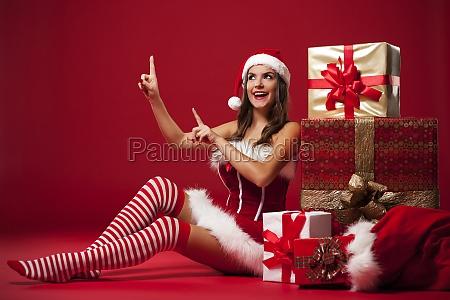 smiling and sexy santa claus woman