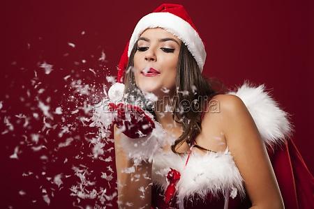 santa woman with christmas sack blowing