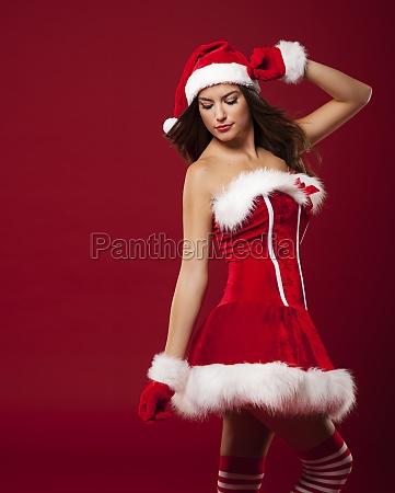 sexy woman wearing santa claus clothes
