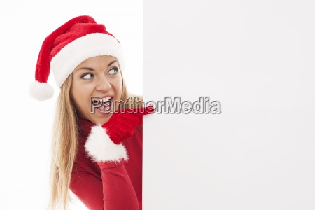 christmas woman pointing at copyspace