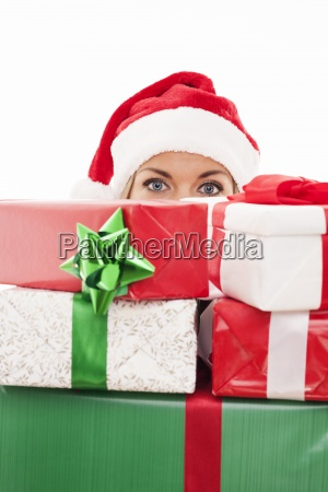 woman holding christmas present in front