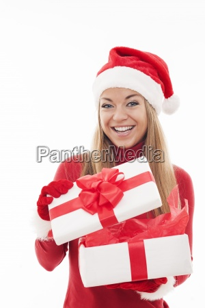 excited woman opening white gift box