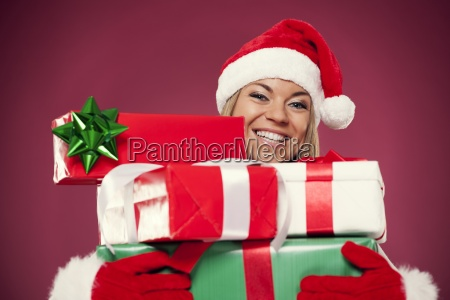happy woman holding christmas presents
