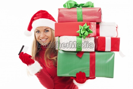 beautiful woman holding christmas presents and